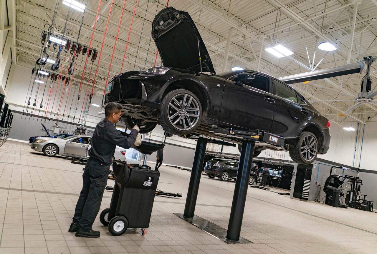 mechanic servicing vehicle